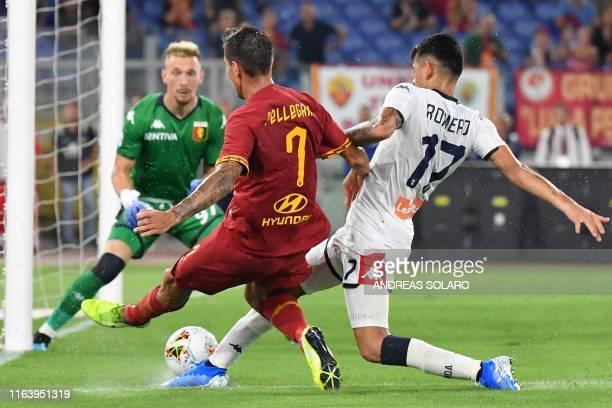 AS Roma's Italian midfielder Lorenzo Pellegrini shoots on goal despite Genoa's Argentinian defender Cristian Romero during the Italian Serie A...