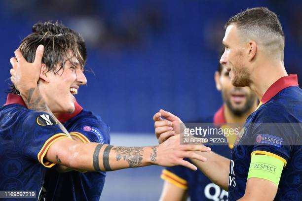 Roma's Italian midfielder Nicolo Zaniolo celebrates AS Roma's Bosnian forward Edin Dzeko after scoring during the UEFA Europa League Group J football...