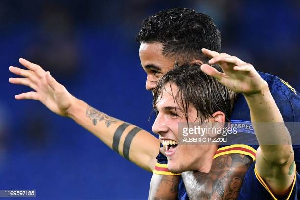 Roma's Italian midfielder Nicolo Zaniolo celebrates with AS Roma's Dutch forward Justin Kluivert after scoring during the UEFA Europa League Group J...