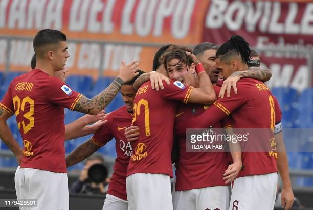 AS Roma's Italian midfielder Nicolo Zaniolo celebrates with teammates after scoring a goal during the Italian Serie A football match between AS Roma...