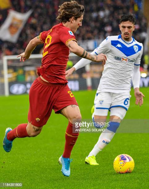 AS Roma's Italian midfielder Nicolo Zaniolo challenges Brescia's Albanian midfielder Emanuele Ndoj during the Italian Serie A football match Roma vs...