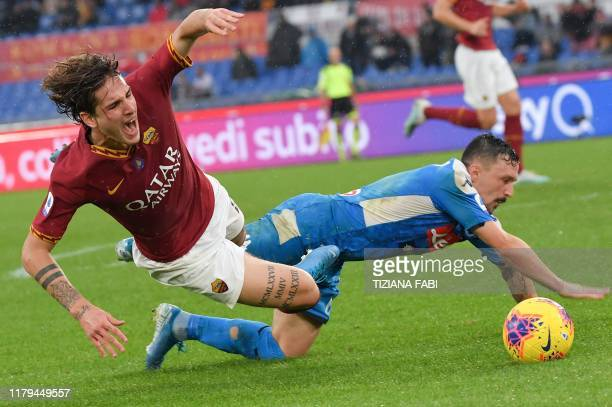 Roma's Italian midfielder Nicolo Zaniolo fights for the ball with Napoli's Portuguese defender Mario Rui during the Italian Serie A football match...
