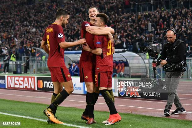 Roma's Italian striker Stephan El Shaarawy celebrates with Roma's Dutch midfielder Kevin Strootman and Roma's Bosnian striker Edin Dzeko after...