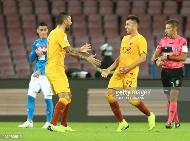 Roma's Italian striker Stephan El Shaarawy celebrates with teammate Roma's Serbian defender Aleksandar Kolarov after scoring a goal during the...