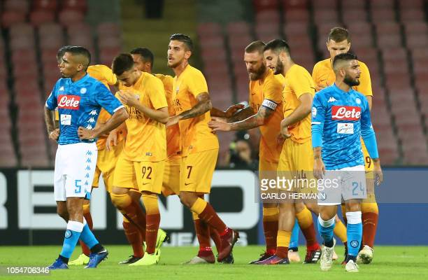 Roma's Italian striker Stephan El Shaarawy celebrates with teammates after scoring a goal next to Napoli's midfielder from Brazil Allan and Napoli's...