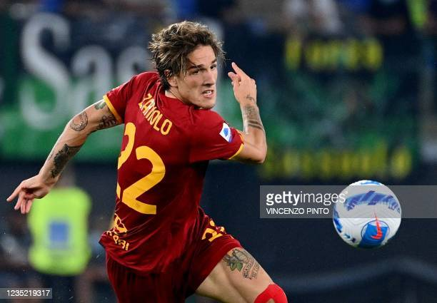 Roma's Italy's midfielder Nicolo Zaniolo eyes the ball during the Italian Serie A football match between AS Roma and Sassuolo at the Olympic stadium...