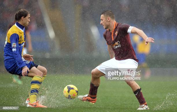 AS Roma's Itlian forward Francesco Totti vies for the ball with Parma's Argentinian defender Gabriel Paletta during the Italian Serie A football...