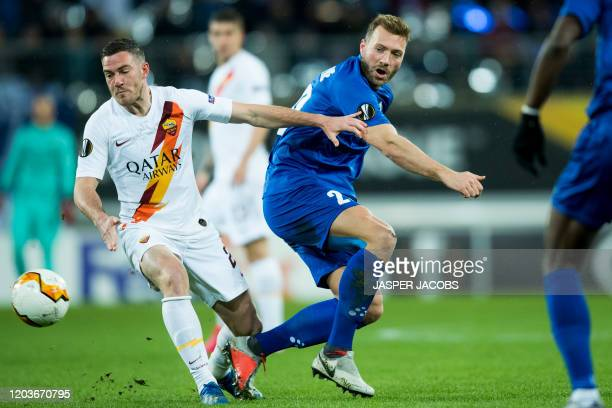 AS Roma's Jordan Veretout and Gent's Laurent Depoitre fight for the ball during the return match in the 1/16 finals of the UEFA Europa League between...