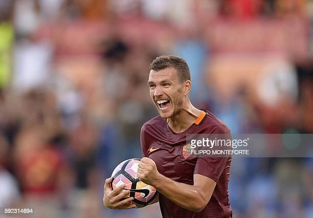 Roma's Macedonian forward Edin Dzeko celebrates during the Italian Serie A football match between Roma and Udinese at the Olympic Stadium in Rome on...