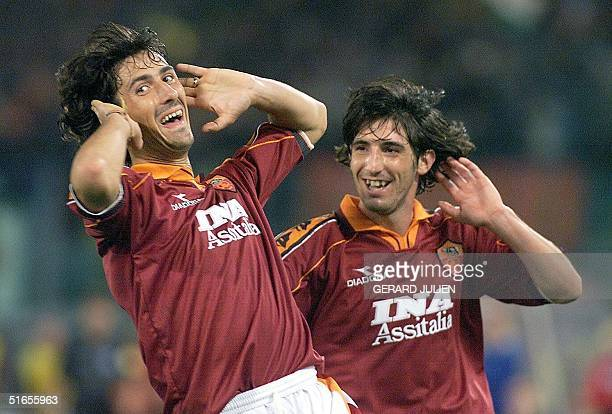 Roma's Marco Delvecchio jubilates with teammate Alessandro Frau after he scored his team's first goal during a second round first-leg of the UEFA...