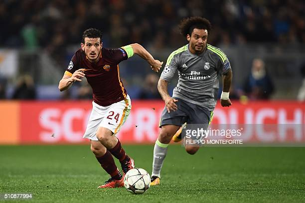Roma's midfielder Alessandro Florenzi fights for the ball with Real Madrid's Brazilian defender Marcelo during the UEFA Champions League football...