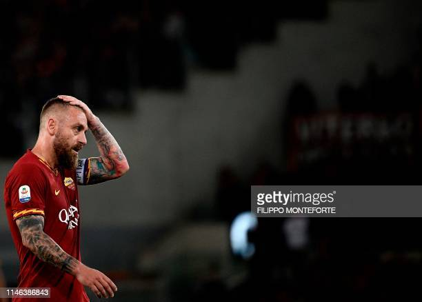 Roma's midfielder Daniele De Rossi gestures during his farewell to Roma after 18 years at his hometown club after the Italian Serie A football match...