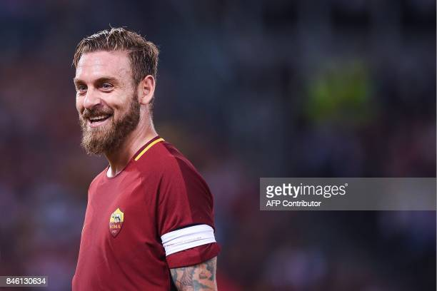Roma's midfielder Daniele De Rossi reacts during the UEFA Champions League Group C football match between AS Roma and Atletico Madrid on September 12...