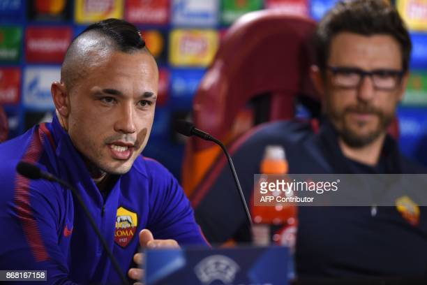 AS Roma's midfielder from Belgium Radja Nainggolan and AS Roma's headcoach Eusebio Di Francesco attend a press conference on the eve of the UEFA...