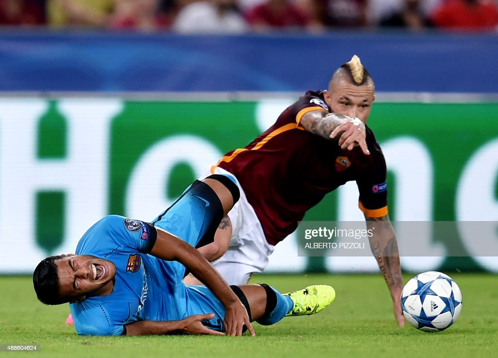 Roma's midfielder from Belgium Radja Nainggolan (R) clashes with Barcelona's Brazilian midfielder Rafinha during the UEFA Champions League football match between AS Roma and FC Barcellona at Rome Olympic stadium, on September 16, 2015 .
