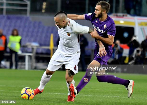 Roma's midfielder from Belgium Radja Nainggolan fights for the ball with Fiorentina's Argentinian defender German Pezzella during the Italian Serie A...