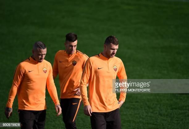 AS Roma's midfielder from Belgium Radja Nainggolan forward Stephan El Shaarawy and forward from Bosnia ed Erzegovina Edin Dzeko take part in a...