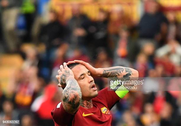 Roma's midfielder from Belgium Radja Nainggolan reacts during the Italian Serie A football match AS Roma vs Fiorentina on April 7 2018 at the Olympic...