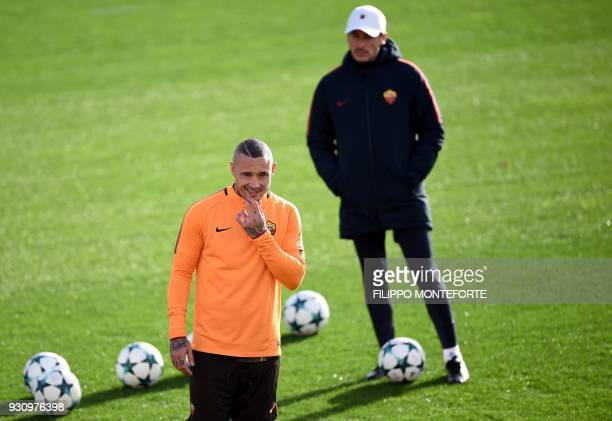 AS Roma's midfielder from Belgium Radja Nainggolan takes part in a training session a day before Champion's League round of 16 secondleg football...
