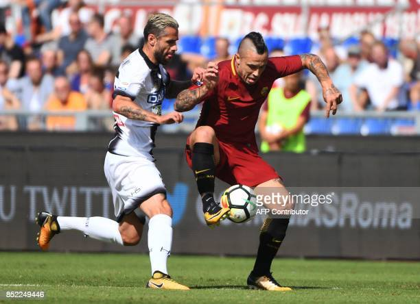 Roma's midfielder from Belgium Radja Nainggolan vies with Udinese midfielder from Switzerland Valon Behrami during the Italian Serie A football match...