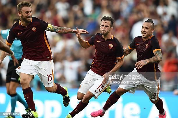 Roma's midfielder from BosniaHerzegovina Miralem Pjanic celebrates with Roma's midfielder from Belgium Radja Nainggolan and Roma's midfielder from...