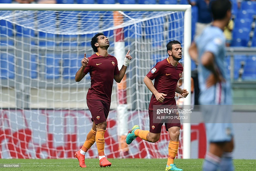 AS Roma's midfielder from Egypt Mohamed Salah (L) celebrates after scoring a goal during the Italian Serie A football match between As Roma and Sampdoria on September 11, 2016 at Olympic stadium in Rome. / AFP / ALBERTO