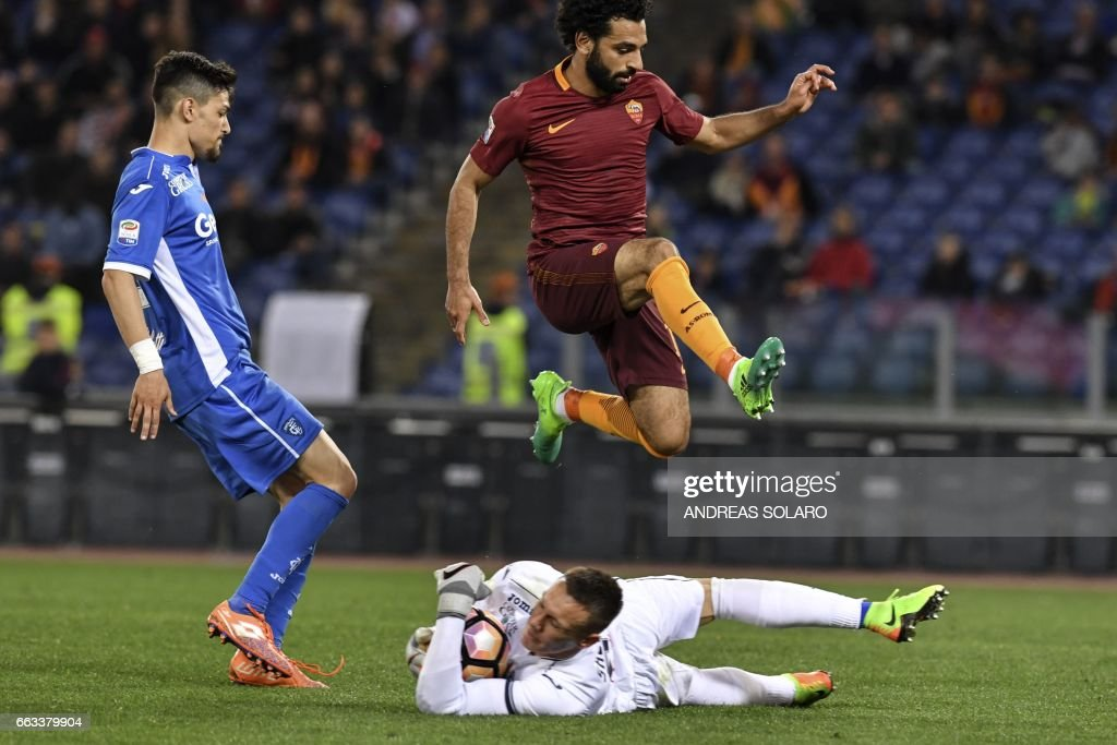 AS Roma's midfielder from Egypt Mohamed Salah (C-top) jumps over Empoli's goalkeeper from Poland Lukasz Skorupski (R) during the Italian Serie A football match AS Roma versus Empoli on April 1, 2017 at Olympic stadium in Rome. /