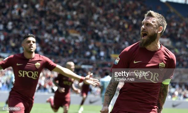 Roma's midfielder from Italy Daniele De Rossi celebrates with teammates after scoring during the Italian Serie A football match Roma vs Lazio at the...