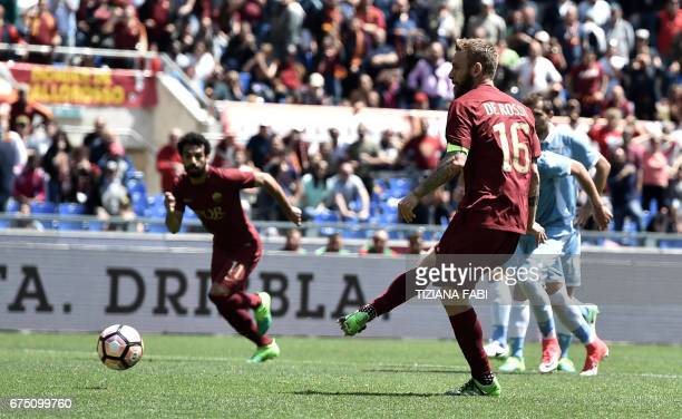 Roma's midfielder from Italy Daniele De Rossi scores during the Italian Serie A football match Roma vs Lazio at the Olympic Stadium in Rome on April...