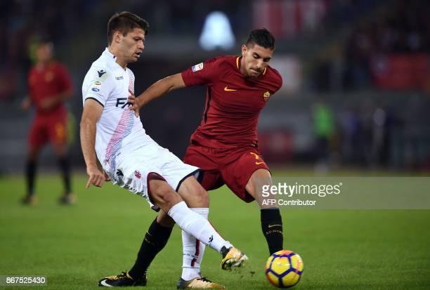 Roma's midfielder Lorenzo Pellegrini vies with Bologna Hungarian midfielder Adam Nagy during the Italian Serie A football match Roma vs Bologna on...