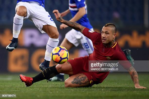 AS Roma's midfielder Radja Nainggolan from Belgium vies with a Sampdoria's player during the Italian Serie A football match between Sampdoria and...