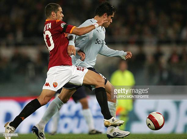 AS Roma's midfielder Simone Perrotta fights for the ball with SS Lazio's Argentine midfielder Cristian Ledesma during their Serie A football match in...