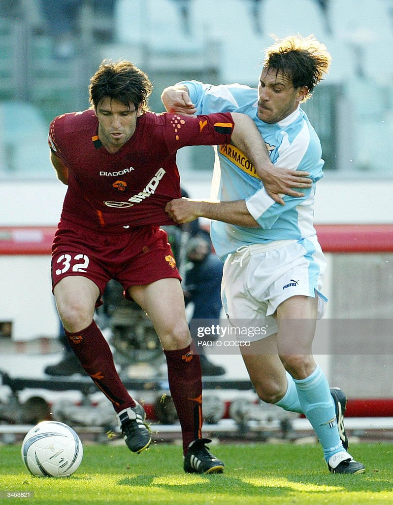 AS Roma's midfielder Vincent Candela of France (L) challenges Lazio's Roberto Muzzi during their Serie A soccer match at Rome's Olympic stadium 21 April 2004.