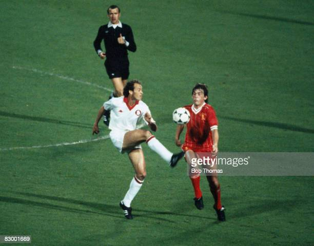 AS Roma's Paolo Falcao challenges Liverpool striker Kenny Dalglish watched by referee Erik Fredriksson during the European Cup Final at the Olympic...