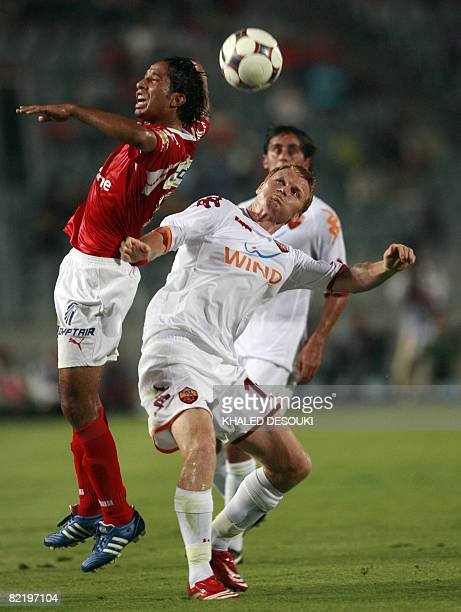 AS Roma's player John Arne Riise vies with Egyptian player Ahmed Hassan of AlAhly club during their friendly football match in Cairo on August 6 2008...