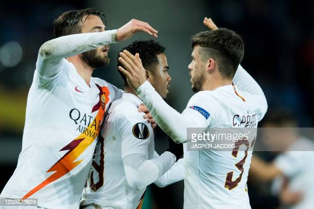 AS Roma's players and AS Roma's Justin Kluivert celebrate after scoring during the return match in the 1/16 finals of the UEFA Europa League between...