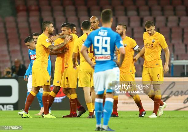 Roma's players celebrate a goal during the Italian Serie A football match SSC Napoli vs AS Roma on October 28 2018 at the San Paolo Stadium