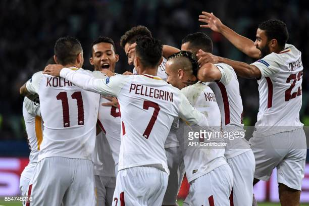 Roma's players celebrate a goal scored by Roma's defender from Greece Konstantinos Manolas during the UEFA Champions League Group C football match...
