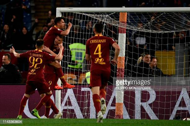 AS Roma's players celebrate after scoring a goal during the Italian Serie A football match between AS Roma and Juventus Turin at the Olympic stadium...