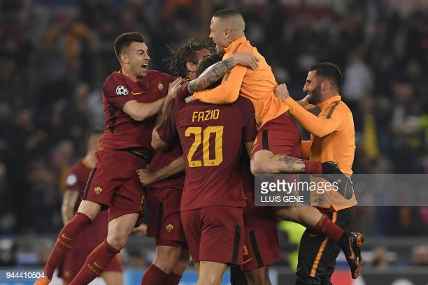 AS Roma's players celebrate after winning the UEFA Champions League quarterfinal second leg football match between AS Roma and FC Barcelona at the...