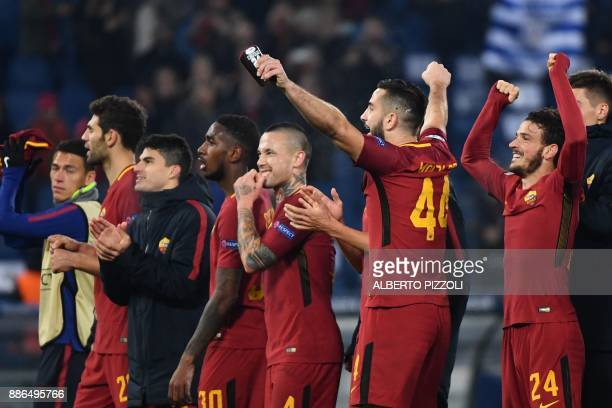 AS Roma's players celebrate at the end of the UEFA Champions League Group C football match AS Roma vs FK Qarabag on December 5 2017 at the Olympic...
