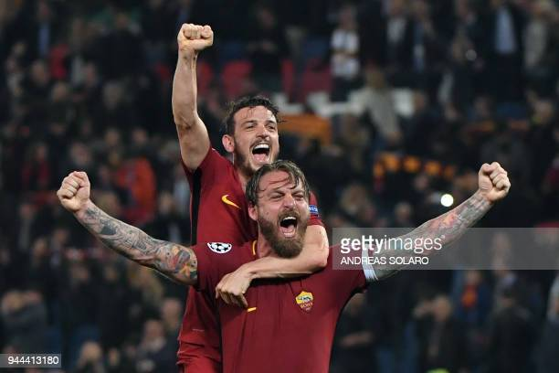 Roma's players celebrate their victory at the end of the UEFA Champions League quarterfinal second leg football match between AS Roma and FC...