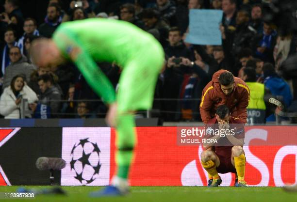 AS Roma's players react to their defeat at the end of the UEFA Champions League round of 16 second leg football match between FC Porto and AS Roma at...