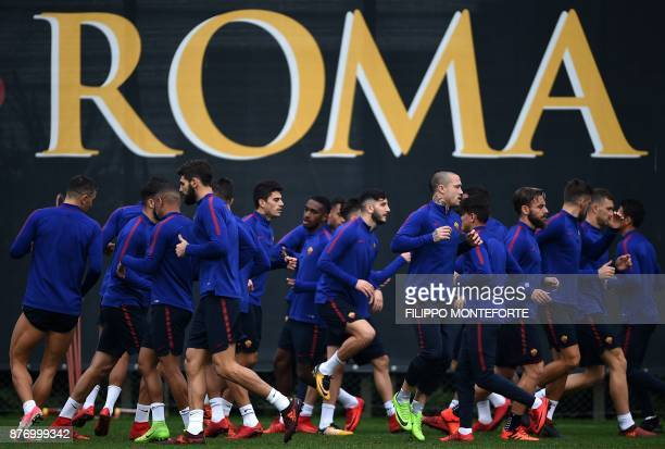 Roma's players run during a training session on the eve of the Champion's League football match Atletico Madrid vs Roma at Trigoria training ground...