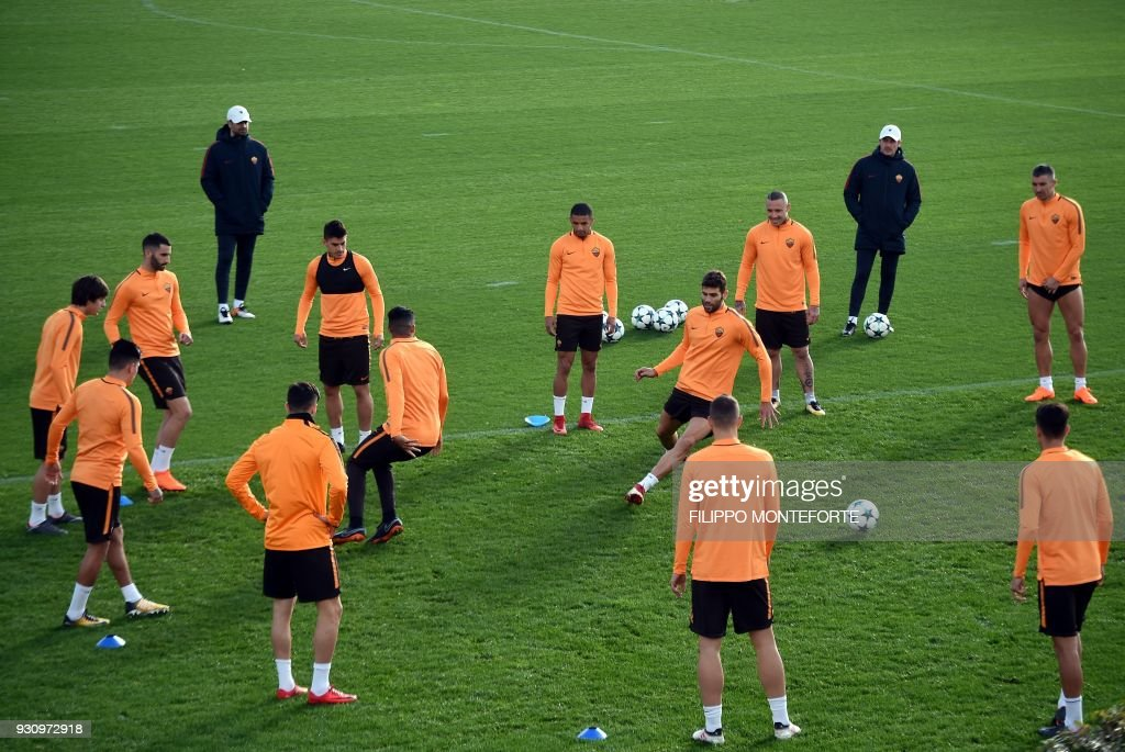 AS Roma's players take part in a training session a day before Champion's League round of 16, second-leg football match AS Roma vs Shakhtar Donetsk on March 12, 2018 at Trigoria training ground in the outskirts of Rome. /
