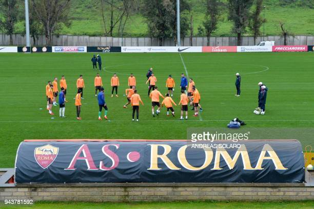 AS Roma's players take part in a training session a day before the Champions League quarterfinal secondleg football match AS Roma vs Barcelona on...