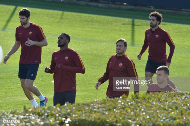 AS Roma's players warm up during a training session on the eve of the team's Europe League football match against Lione at the Trigoria training...