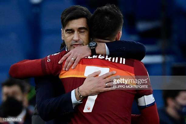 Roma's Portuguese coach Paulo Fonseca embraces Roma's Italian midfielder Lorenzo Pellegrini at the end of the Italian Serie A football match AS Rome...