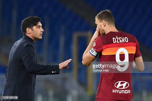 Roma's Portuguese head coach Paulo Fonseca talks with AS Roma's Bosnian forward Edin Dzeko during the Italian Serie A football match Roma vs...
