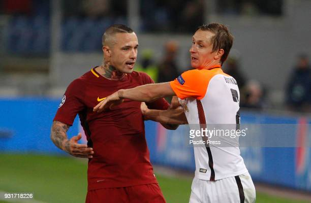 Roma's Radja Nainggolan left argues with Shakhtar Donetsk Bohdan Butko during the Uefa Champions League round of 16 second leg soccer match between...